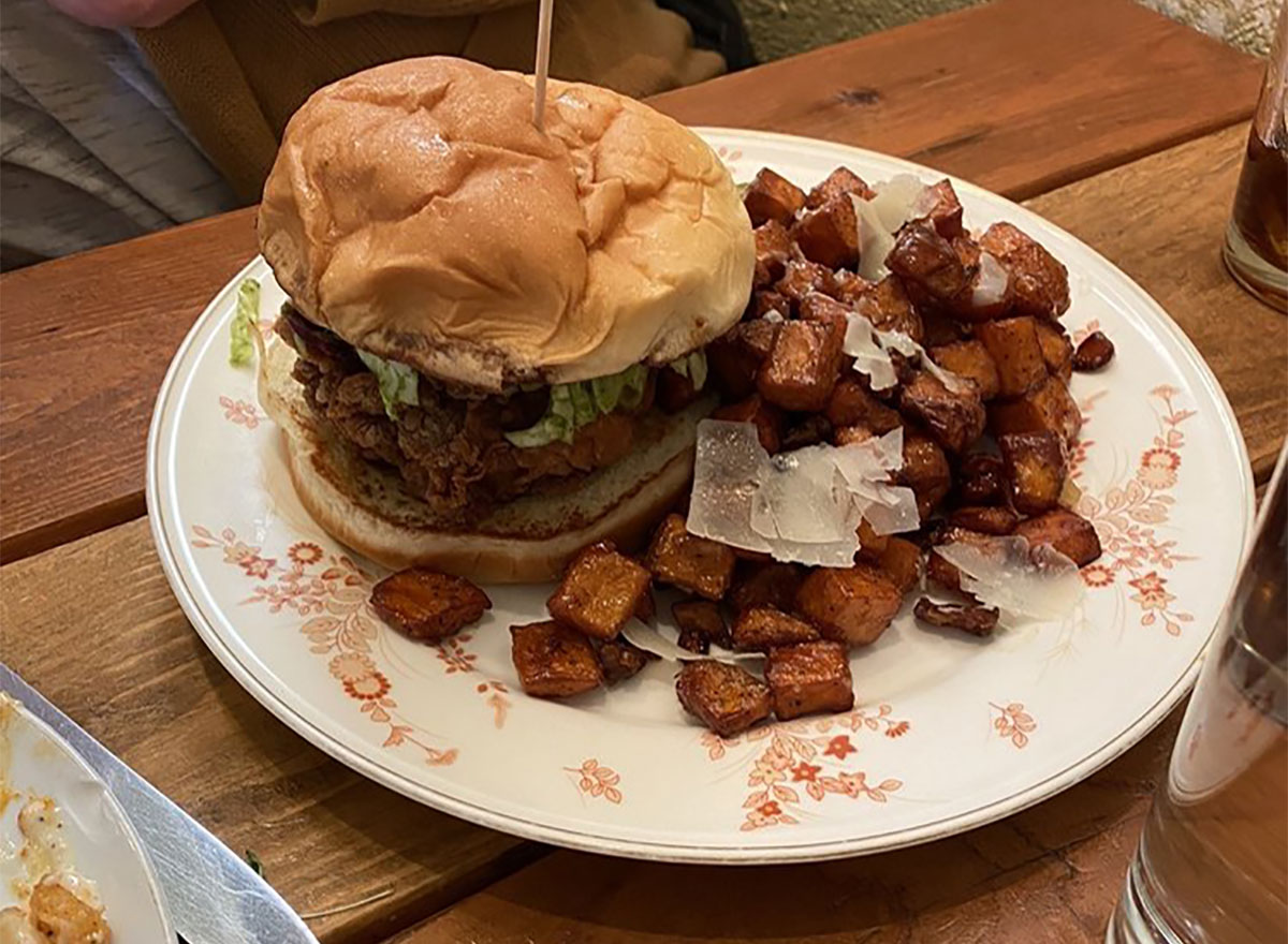 fried chicken sandwich with home fries