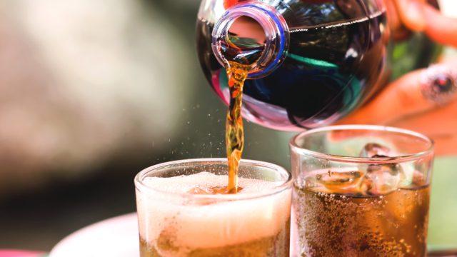 pouring coke soda into glass