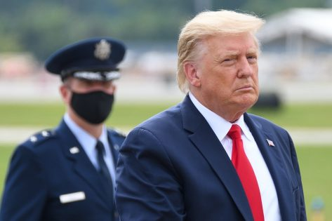 """President Donald Trump walks to """"The Beast"""" limousine with Air Force Major General John"""