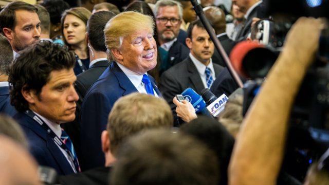 President Donald Trump talks to the media