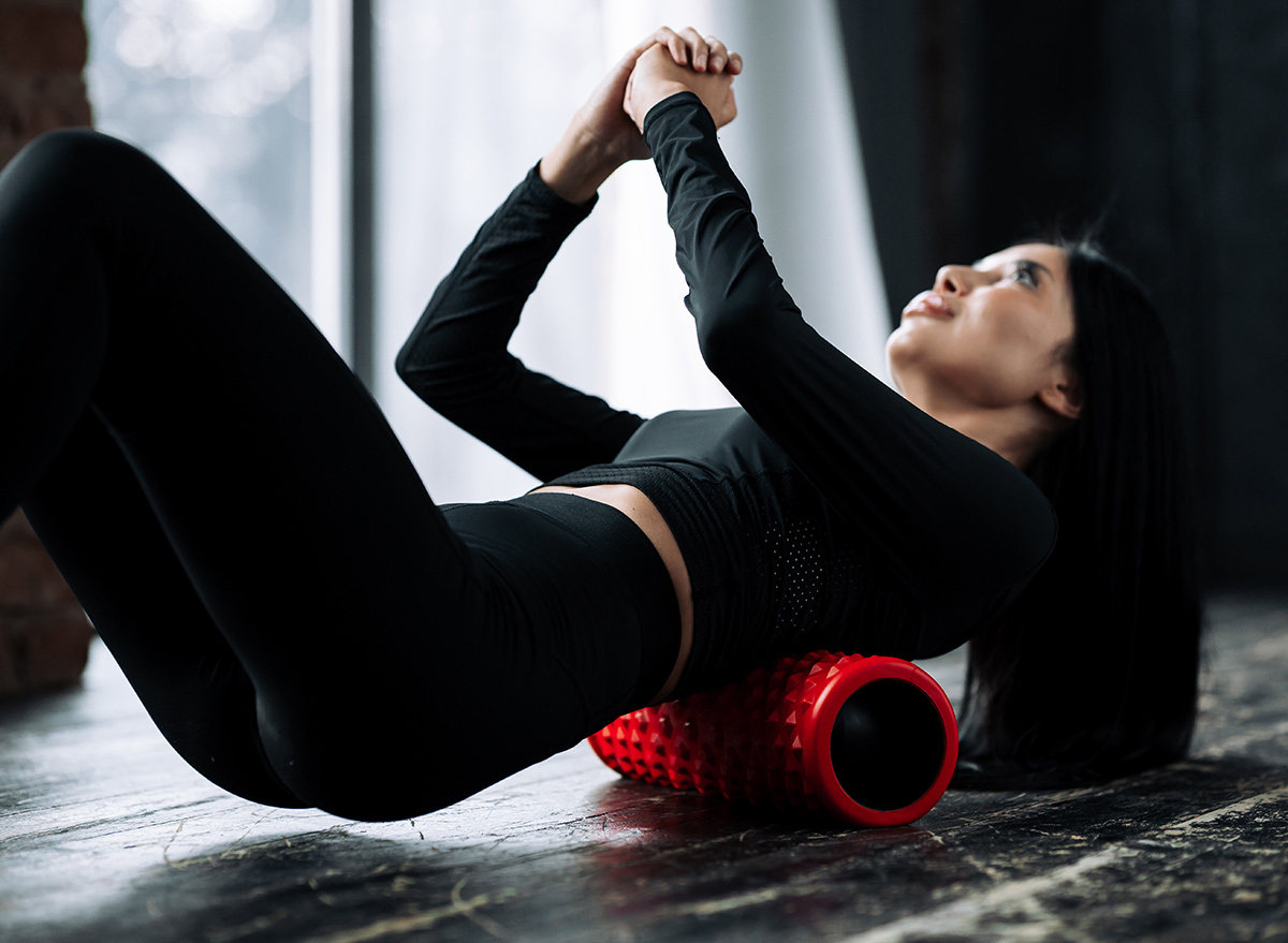 woman rolling out back muscles