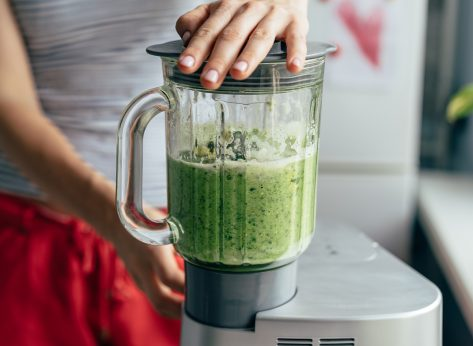 blending up ingredients for a green smoothie