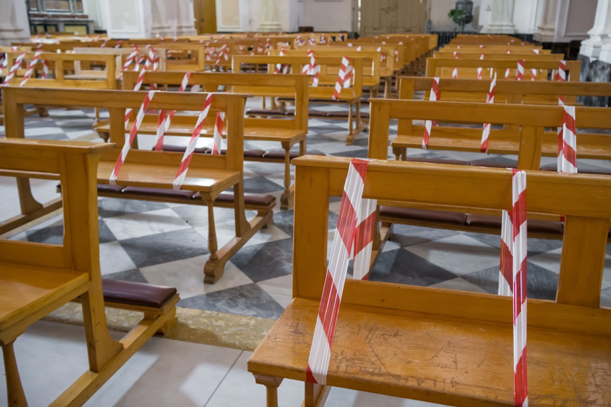 Line strip or warning tape mark empty seats as new social distancing protection measures during pandemic of coronavirus