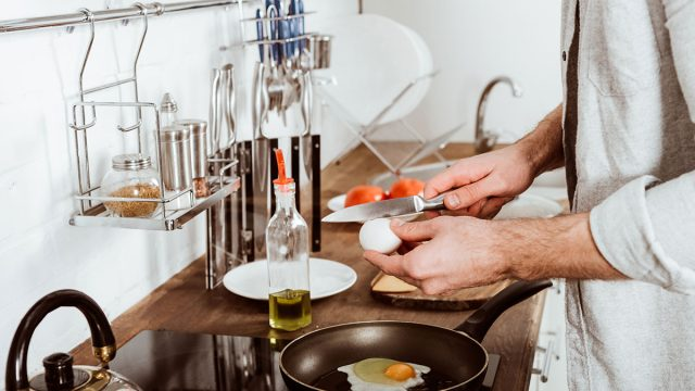 man cooking breakfast