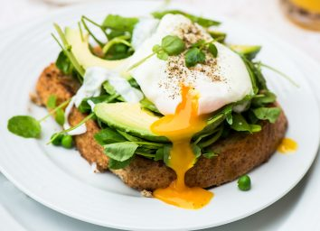 healthy breakfast toast with soft boiled egg and avocado