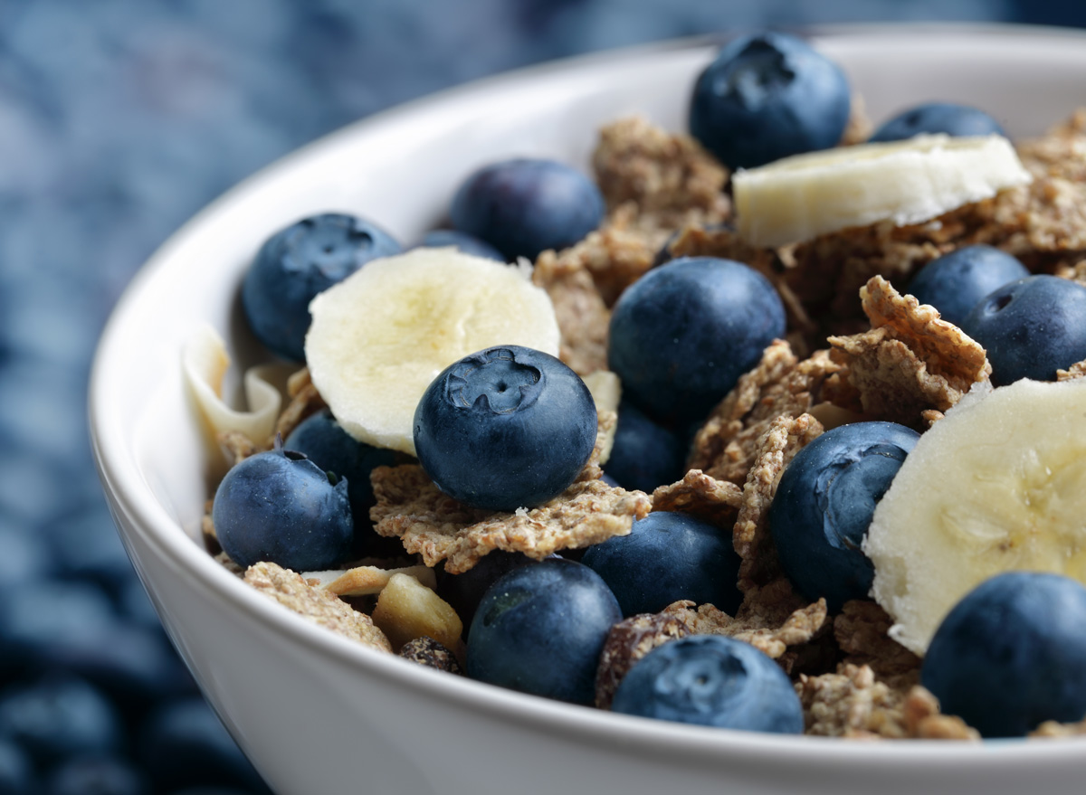 high fiber bowl of bran cereal with blueberries and bananas