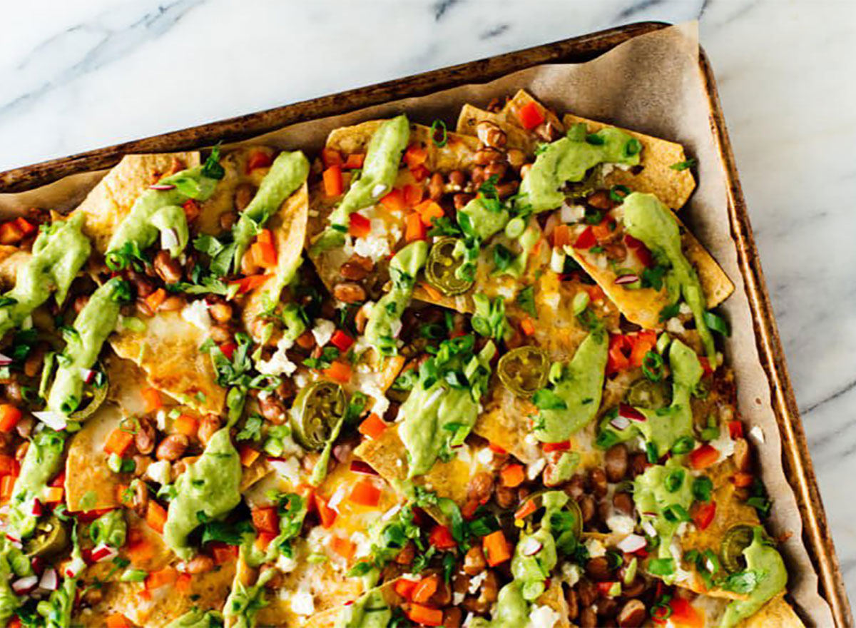loaded vegetable nachos on a sheet pan