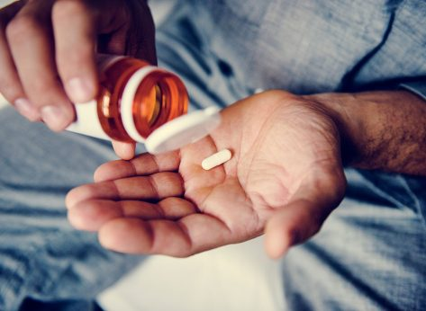 man taking supplement