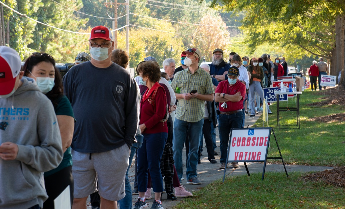 Wake Forest, NC/United States- 10/15/2020: North Carolina voters stand in very long lines to cast their ballots on the first day of early voting.