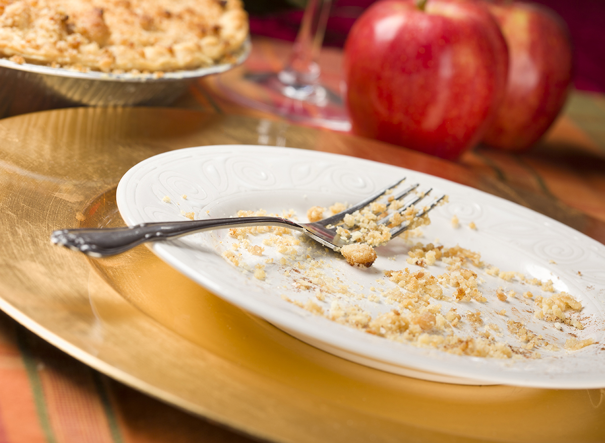 apple pie crumbs on white plate