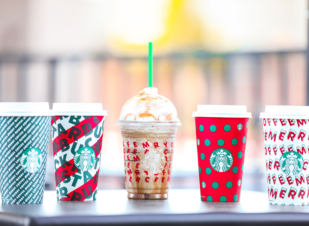 starbucks holiday cups with frappuccino and four hot drinks