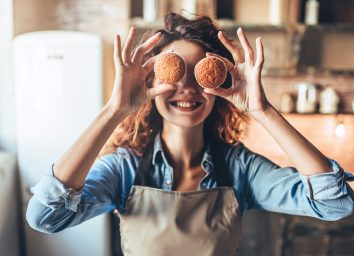 Happy and healthy woman baking muffins