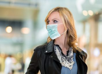 Portrait of blonde woman outdoor wearing a mask