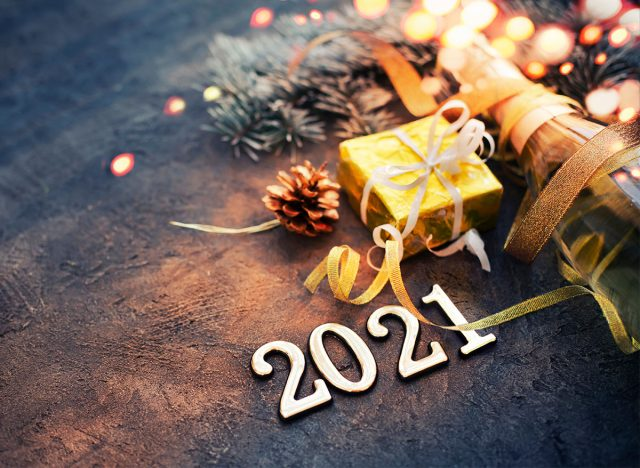 2021 sign with champagne bottle for new years