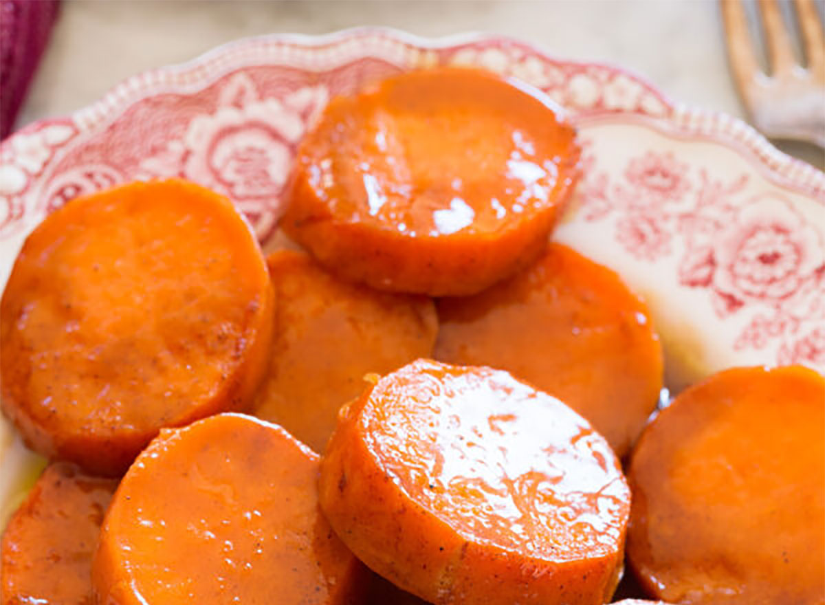 candied yams on plate with fork