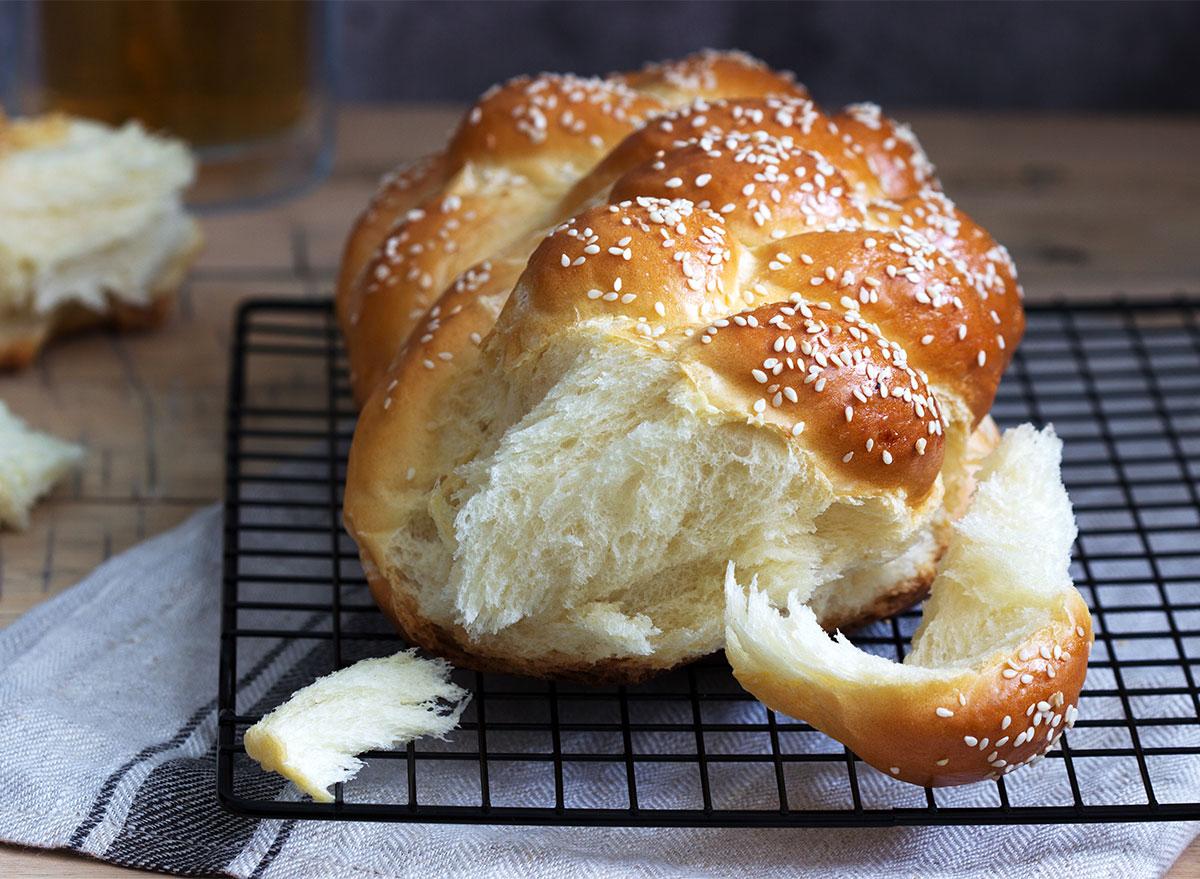 challah loaf on baking rack
