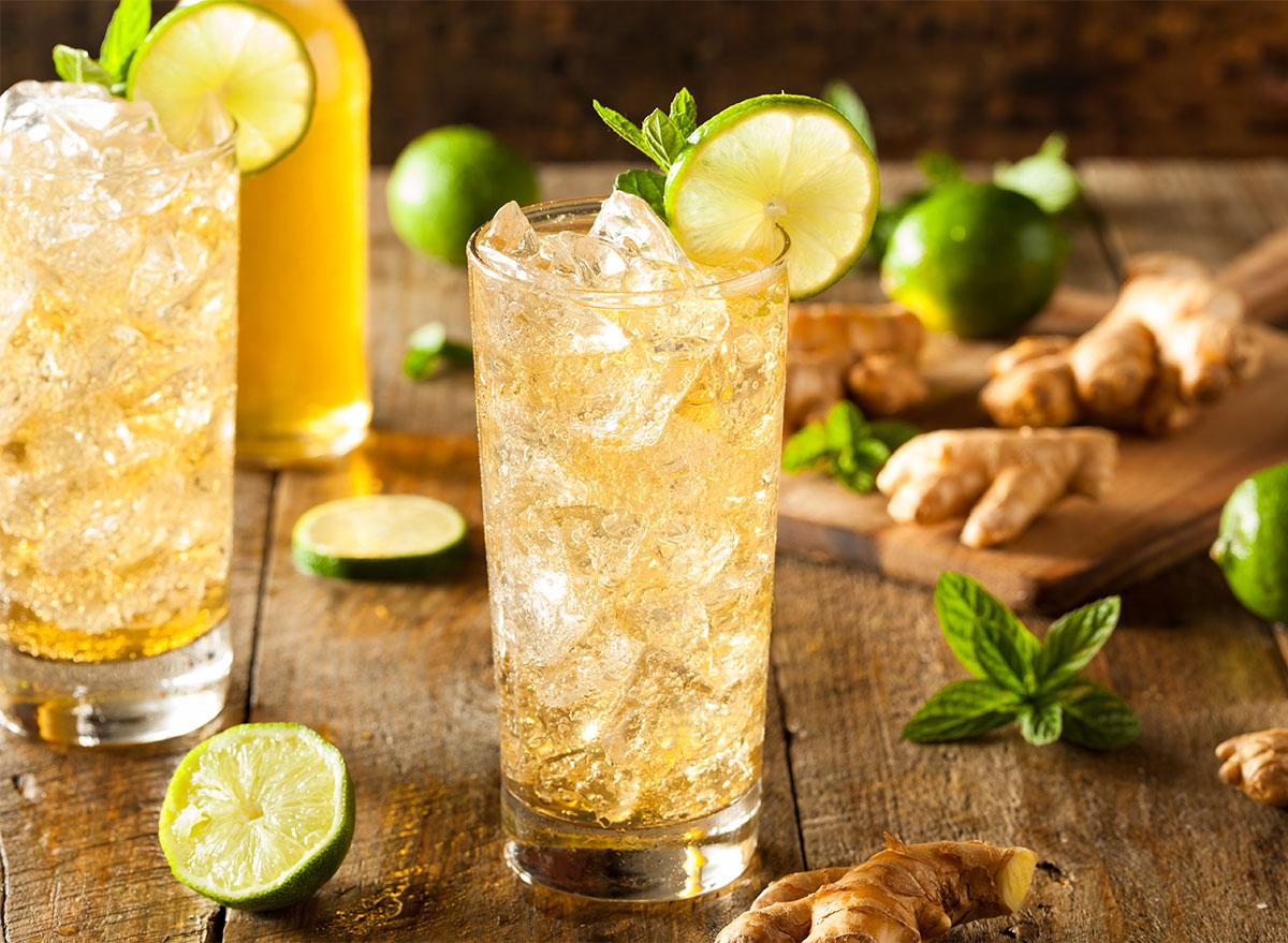 glasses of ginger beer garnished with lime slices