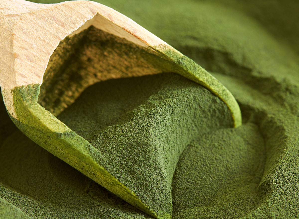 green powder wooden spoon