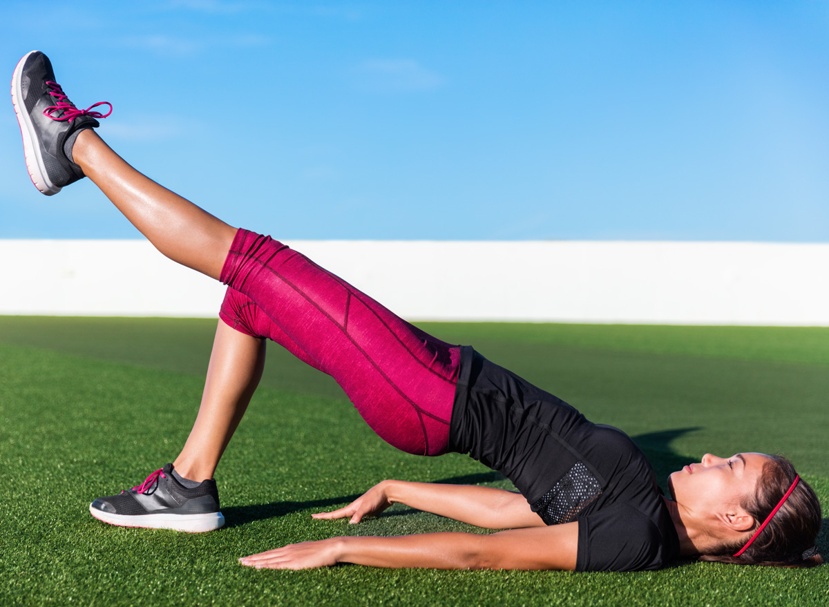 woman hip raise exercise leg extension