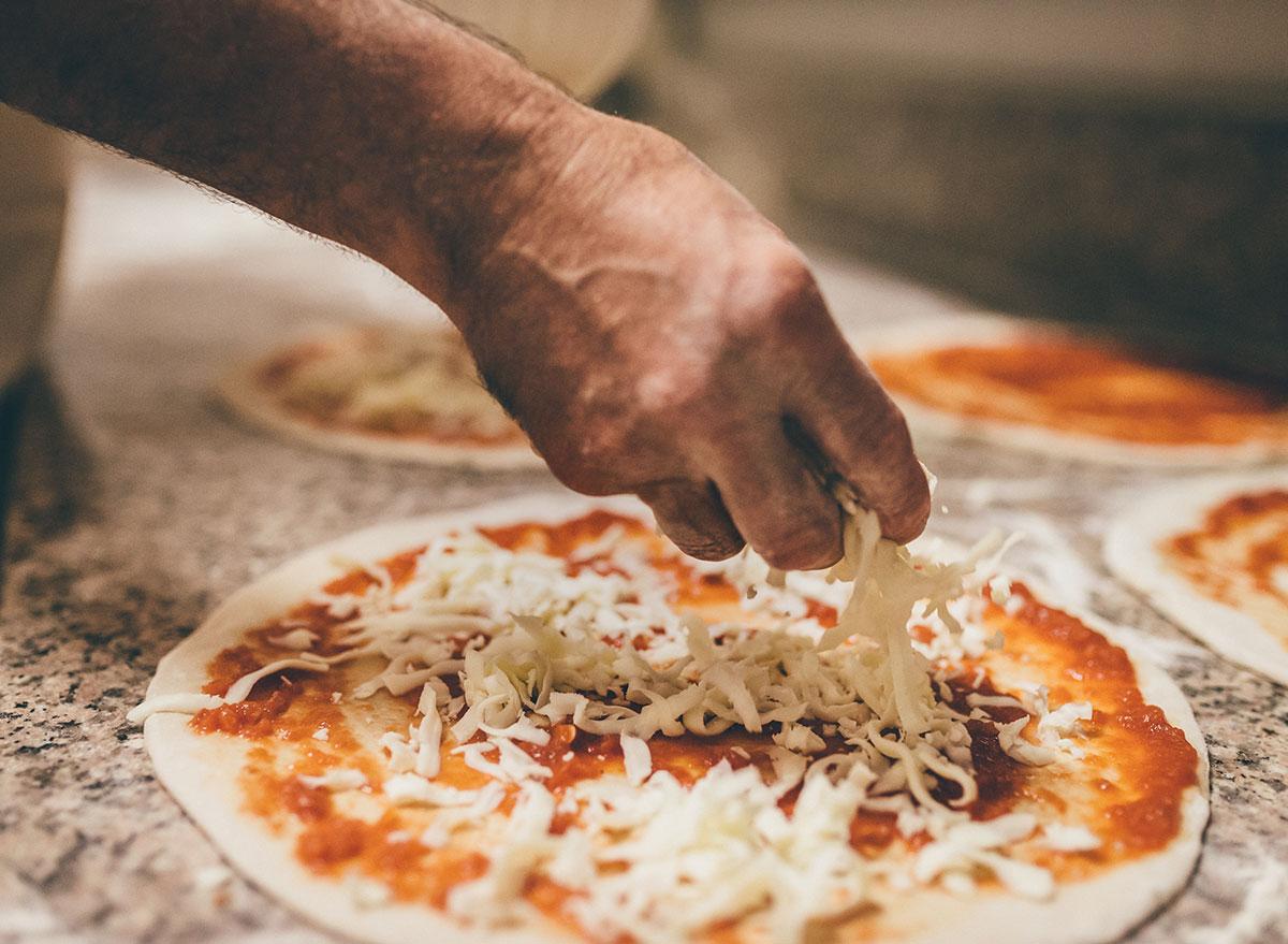 making pizza chunking cheese