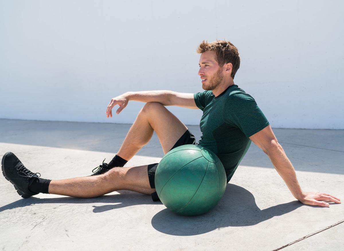 man exercising medicine ball