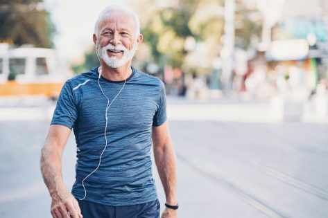 Senior athlete walking outdoors in the city