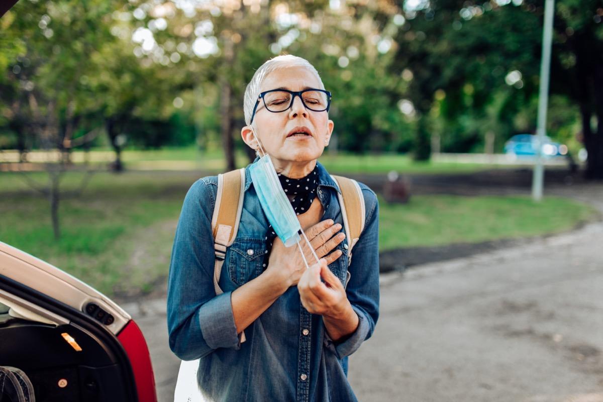 Senior woman having breathing difficulties
