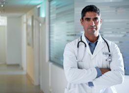 Doctor standing in a hospital corridor.