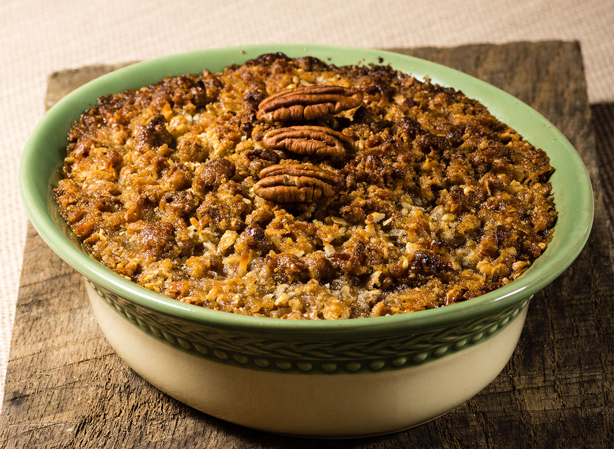 bowl of sweet potato casserole with pecan topping
