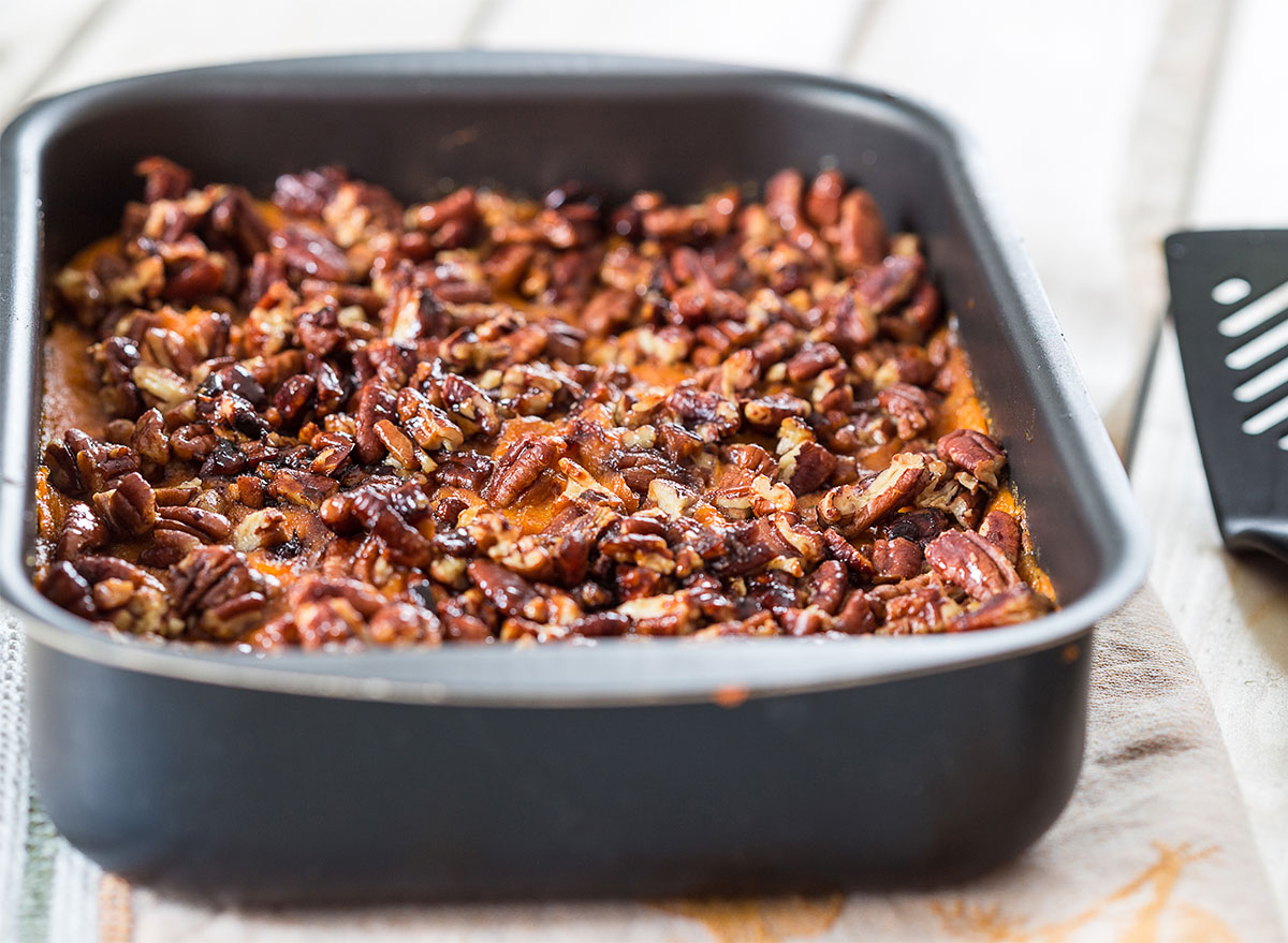 baking tray of sweet potato casserole with pecans