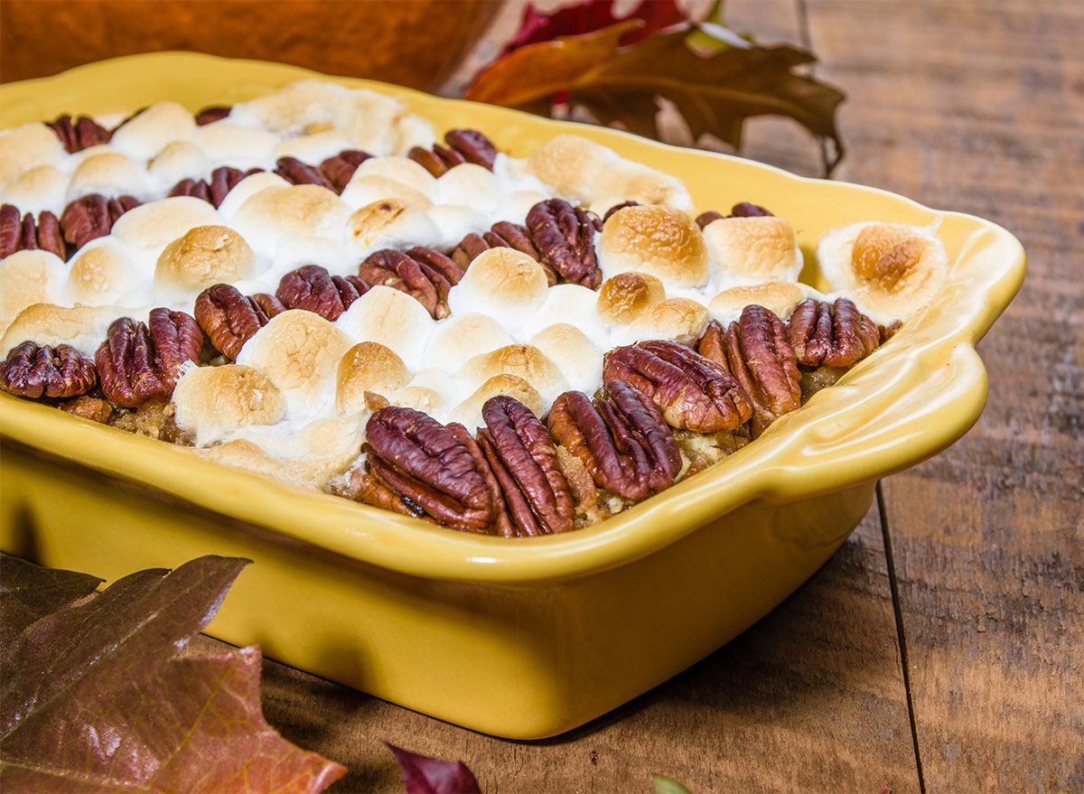 tray of sweet potato casserole topped with pecans and marshmallows