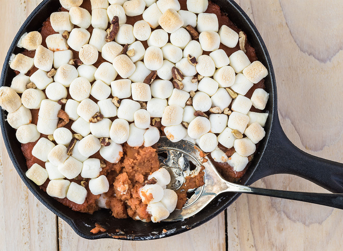 sweet potato casserole in a skillet topped with marshmallows