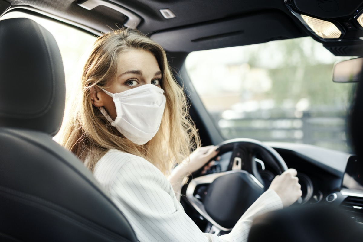 Businesswoman is using a car while working