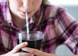 woman drinking diet soda