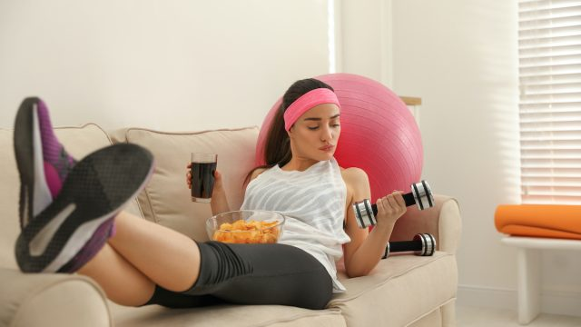 woman drinking a soda before exercise