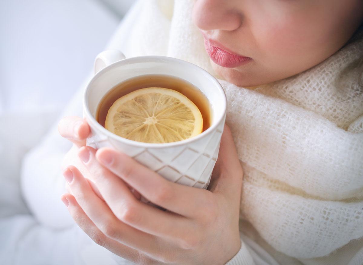 woman drinking tea and lemon