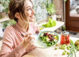 happy woman eating a healthy meal