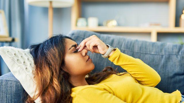 Woman experiencing a bad headache