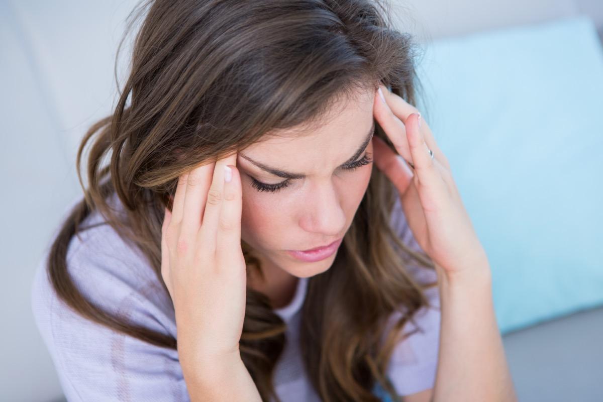 Sick woman suffering from head ache