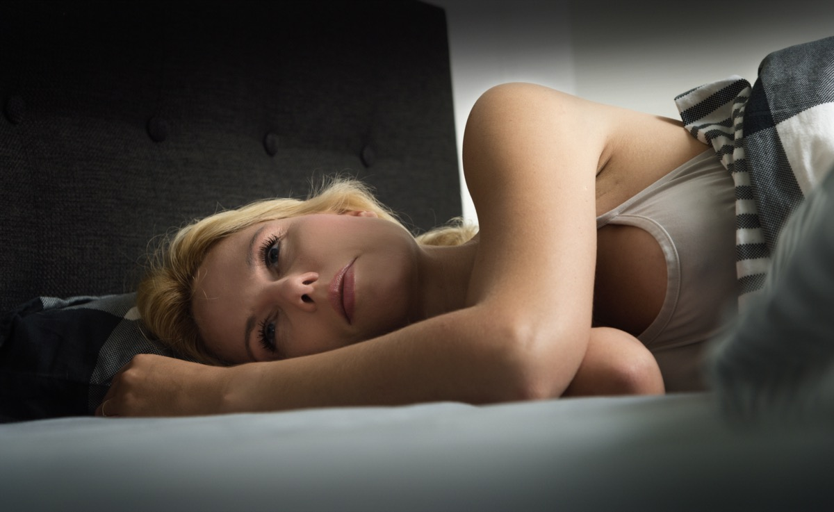 Blond Woman can't sleep at night.