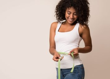 woman measuring inches around belly