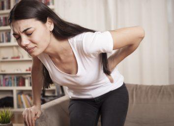 Woman feeling sharp pain.