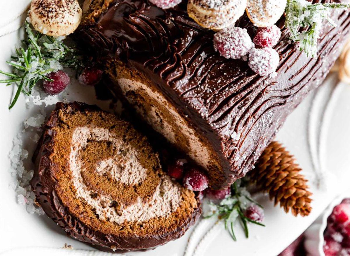 yule log with slice on serving platter