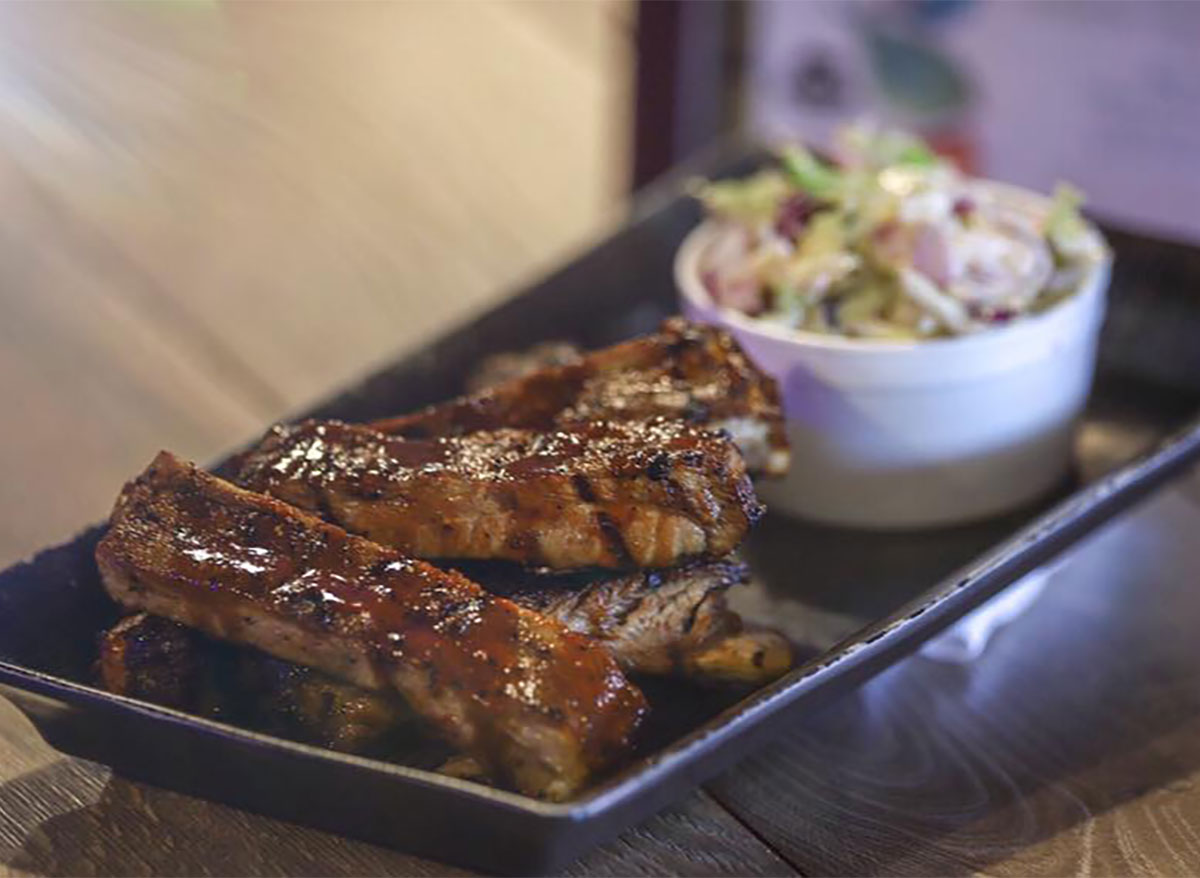 plate of bbq ribs and coleslaw