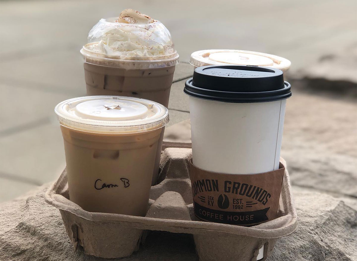 three takeout coffees in a to go container