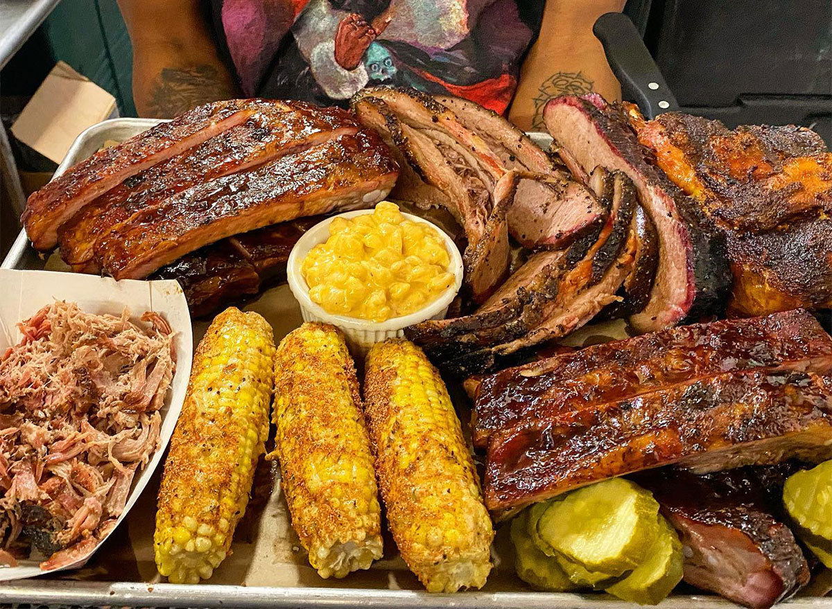 plate of barbecue with corn and mac and cheese
