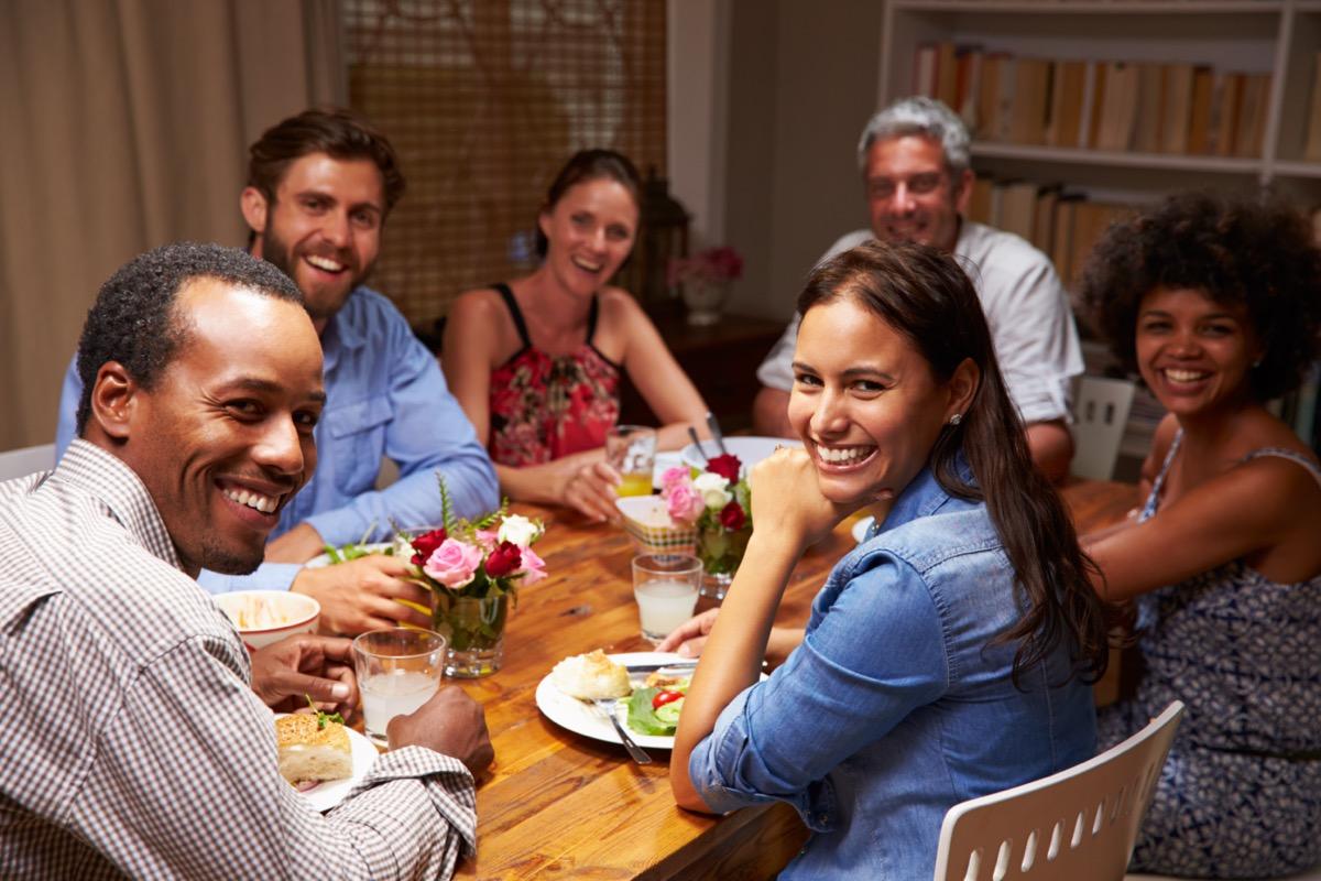 Friends at an evening dinner party.