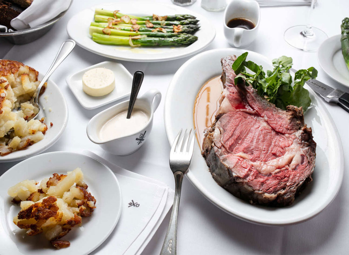 prime rib potatoes and asparagus on table at restaurant