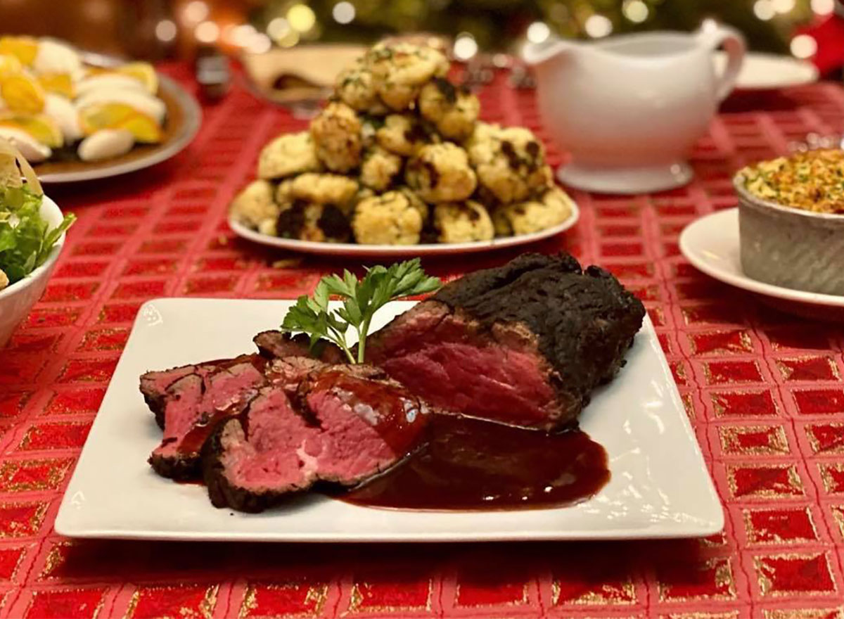 plated prime rib with side dishes