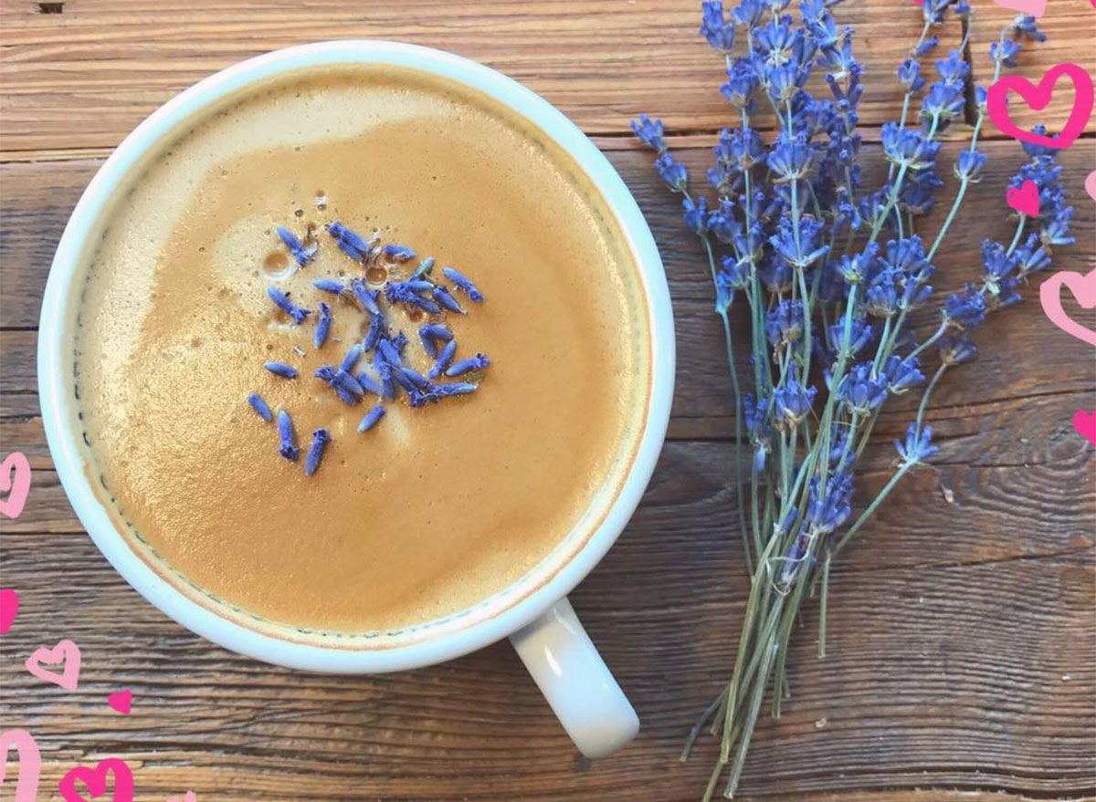 cup of coffee with sprigs of lavender